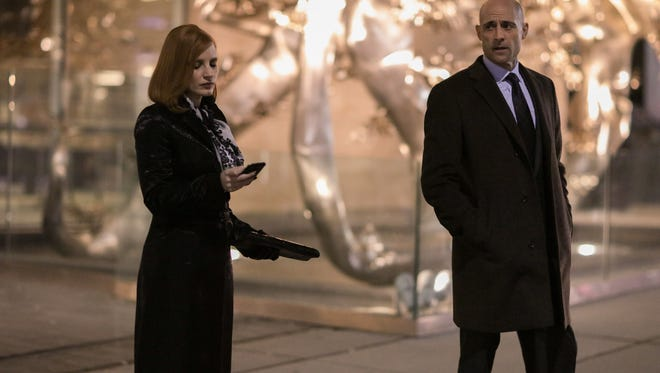 """Jessica Chastain and Mark Strong  in """"Miss Sloane."""""""