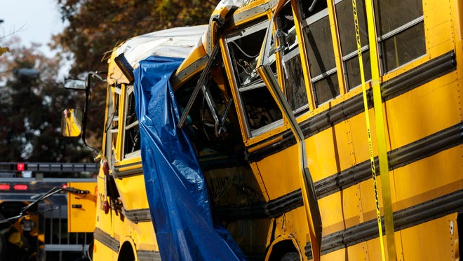 A tarp covers a section of the wreckage the day after a school bus accident, Tuesday, Nov. 22, 2016, in Chattanooga, Tenn.  Johnthony Walker, 24, the bus driver, who authorities say was speeding, was arrested and charged with vehicular homicide in the deaths of five children. Walker is scheduled to appear in court on Nov. 29 to face charges that also include reckless driving and reckless endangerment. (Doug Strickland/Chattanooga Times Free Press via AP)