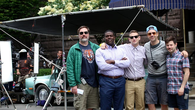 """The cast of the Comedy Central pilot, """"Detroiters"""": Joe Kelly, from left, Sam Richardson, Tim Robinson, executive producer Jason Sudeikis, and Zach Kanin in front of the historic Detroit Club in downtown Detroit where they filmed a scene June 12, 2015."""
