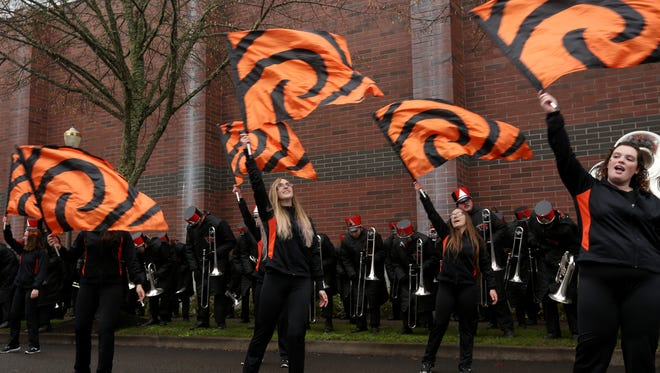 The Beavers color guard performs as tailgaters watch before the Oregon vs. Oregon State Civil War football game at Oregon State University in Corvallis on Saturday, Nov. 26, 2016.