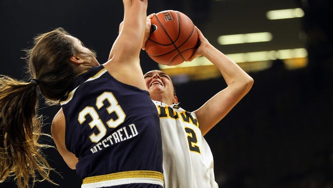 Iowa's Ally Disterhoft shoots over Notre Dame's Kathryn Westbeld during their game at Carver-Hawkeye Arena on Wednesday, Nov. 30, 2016.