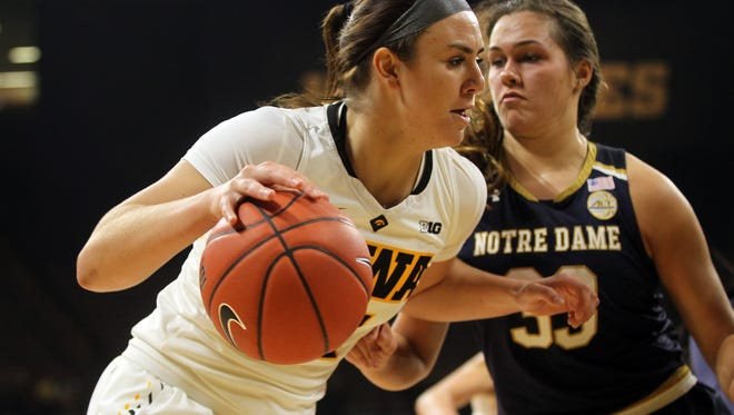 Iowa's Hannah Stewart drives to the hoop during the Hawkeyes' game against Notre Dame at Carver-Hawkeye Arena on Wednesday, Nov. 30, 2016.