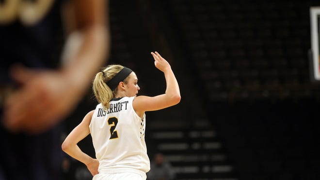 Iowa's Ally Disterhoft celebrates a 3-pointer during the Hawkeyes' game against Notre Dame at Carver-Hawkeye Arena on Wednesday, Nov. 30, 2016.