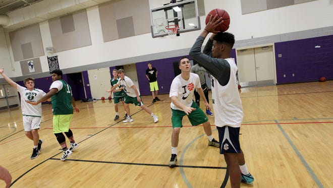 West High teammates run plays during practice at North Central Junior High in North Liberty on Tuesday, Nov. 29, 2016.