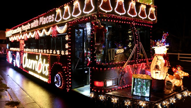 A Cherriots bus is lit up before the  Festival of Lights  parade last year. Organizers of the parade called it quits but the city of Keizer stepped in to return decorated floats, automobiles and bands to holiday season.
