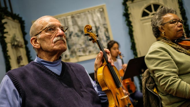 Hal Osgood, 75, of Southfield, MI, violin player for the Detroit Community Orchestra listens during rehearsal on Tuesday November 29, 2016, at the Max M. Fisher Music Center in Detroit, MI. Detroit Symphony Orchestra started a community orchestra few months ago, an amateur ensemble comprised of adults who used to play an instrument and have them practice side-by-side with DSO musicians.
