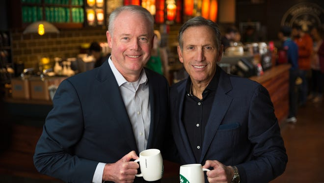 Kevin Johnson, Starbucks president and chief operating officer, is shown with Howard Schultz, chairman and chief executive officer, in a Starbucks store at the corporate headquarters in Seattle in December 2016.