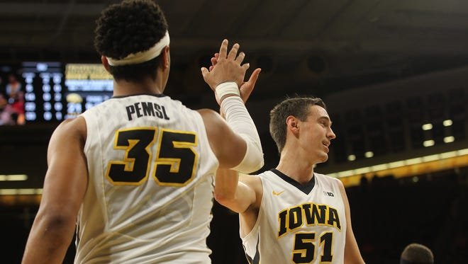 Iowa's Nicholas Baer (51) high-five's Cordell Pemsl during the Hawkeyes' game against Stetson at Carver-Hawkeye Arena on Monday, Dec. 5, 2016.