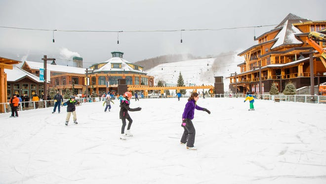 At Stowe's Spruce Peak Village Center families can keep the fun going after a day on the slopes with a variety of activities including ice skating, rock climbing, shopping or dining.