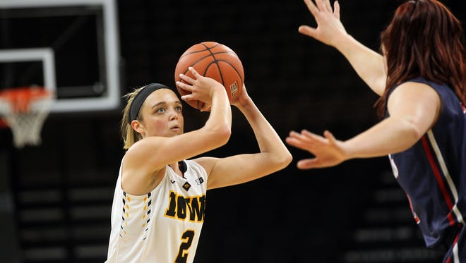 Iowa's Ally Disterhoft shoots a 3-pointer during the Hawkeyes' game against Robert Morris at Carver-Hawkeye Arena on Friday, Dec. 9, 2016.