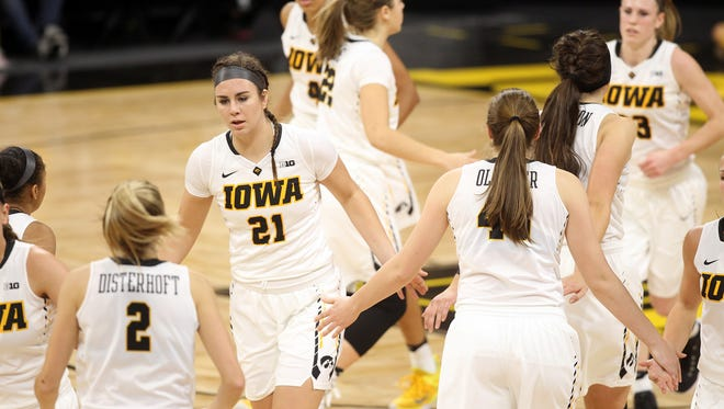 Iowa teammates sub in and out during their game against Robert Morris at Carver-Hawkeye Arena on Friday, Dec. 9, 2016.