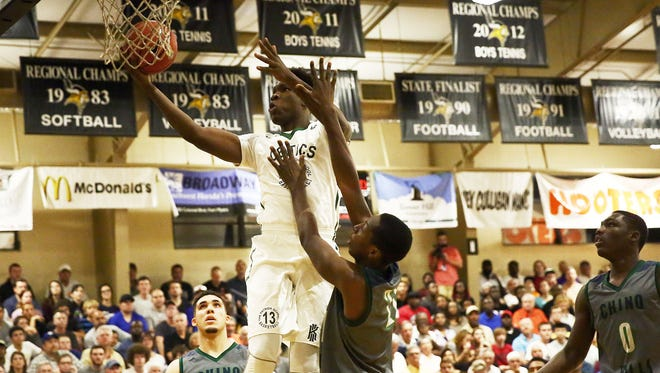 Patrick School senior Cyril Langevine shoots a layup during the championship game of the City of Palms Classic at Bishop Verot High School in Fort Myers in  2015. Chino Hills won with a final score of 66-60.