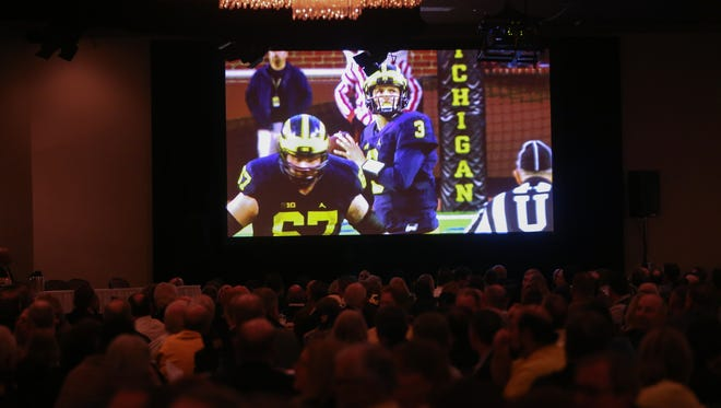 Michigan fans watched a video of the season at the U-M football bust held at Laurel Park Manor in Livonia on Tuesday.