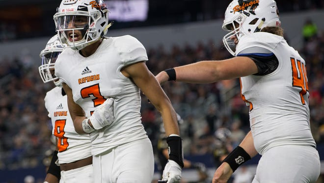 Refugio's Robert Ortiz celebrates after scoring a touchdown during the first quarter of the Class 2A Division I state championship game against Crawford at AT&T Stadium in Arlington Texas on Thursday Dec. 15, 2016.