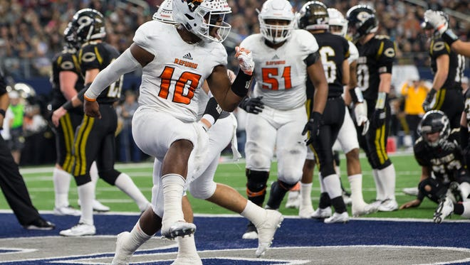 Refugio's quarterback Jacobe Avery celebrates after score a touchdown during the second quarter of the Class 2A Division I state championship game against Crawford at AT&T Stadium in Arlington Texas on Thursday Dec. 15, 2016. Avery was named the player of the game.
