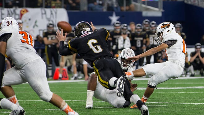 Refugio's kicker Diego Gonzales kids the game winning field goal during the fourth quarter of the Class 2A Division I state championship game against Crawford at AT&T Stadium in Arlington Texas on Thursday, Dec. 15, 2016.