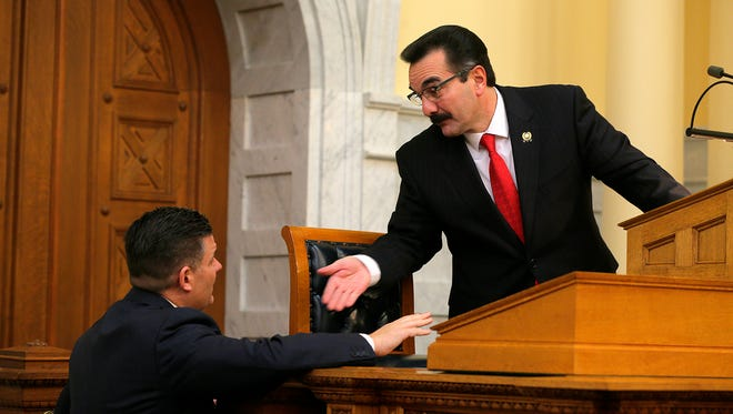 Assembly Majority Leader Louis Greenwald, left, talking with Assembly Speaker Vincent Prieto on Monday.