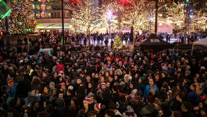 A large crowd gathers for the 6th annual Menorah in the D menorah lighting ceremony on Tuesday December 27, 2016 at Campus Martius in downtown Detroit.