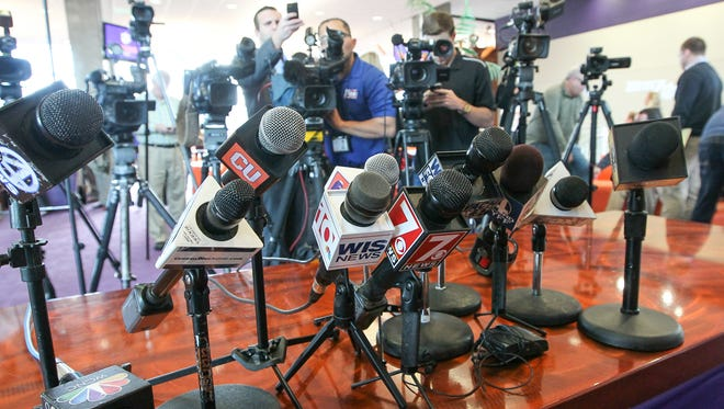 Microphones are lined up for media day on Wednesday at Memorial Stadium in Clemson.