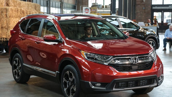 The new 2017 Honda CR-V crossover is seen on display after being revealed at Eastern Market in Detroit on Wednesday October 12, 2016.