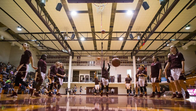 Flour Bluff players warms up before their game against Carroll at Flour Bluff High School on Friday, Jan. 6, 2016.