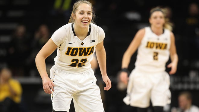 Iowa's Kathleen Doyle smiles after a basket during the Hawkeyes' game against Illinois at Carver-Hawkeye Arena on Wednesday, Jan. 11, 2017.