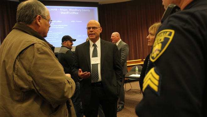 Coralville Police Chief candidate Michael Venema chats with guests during a reception at Coralville City Hall on Friday, Jan. 13, 2017.