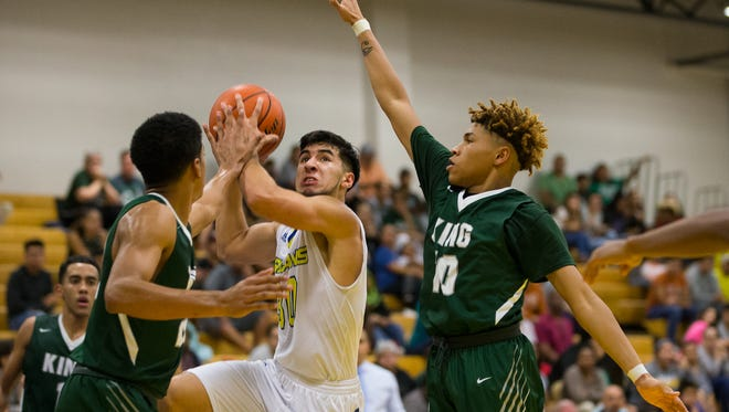 Moody's John Cantu jumps to shoot as King's Jalen Hogg and Andre Rivera block him during the third quarter of their game at Moody High School on Tuesday, Jan. 17, 2017.