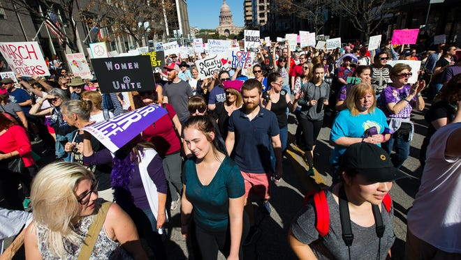 Protesters march down Congress Avenue as they take part in the Austin Women's March on Jan. 21, 2017.