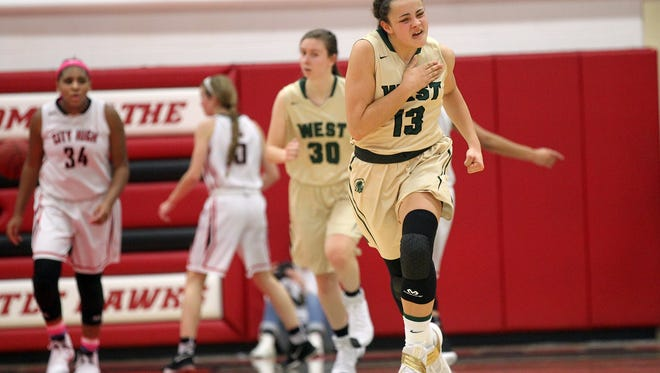 West High's Rachael Saunders celebrates a 3-pointer during the Women of Troy's game at City High on Tuesday, Jan. 24, 2017.