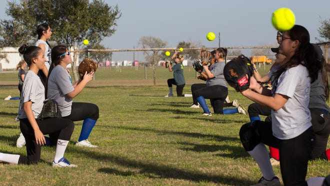 Santa Gertrudis Academy's softball team warms up during practice at Dick Kleberg Park in Kingsville on Tuesday, Jan, 24, 2017.