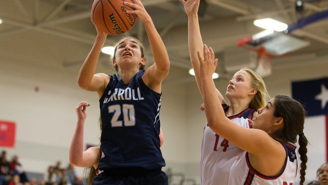 Carroll's Izzy Beletic jumps for a rebound during the first quarter of their game against Veterans Memorial at Veterans Memorial on Friday, Jan. 27, 2017.