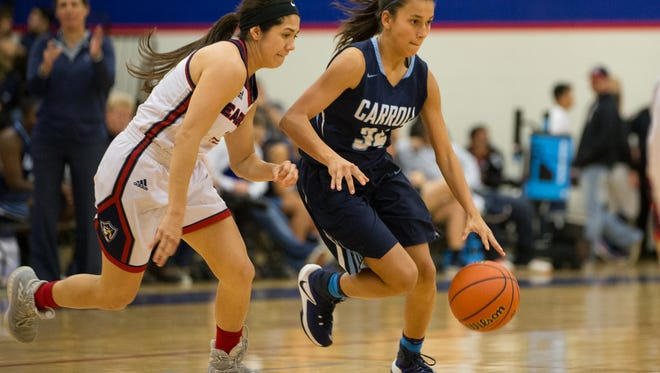 Carroll's Alyssa Cortez drives the ball up the court as Veterans Memorial's Rock Benavides guards her during the second quarter of their game at Veterans Memorial on Friday, Jan. 27, 2017. The Tigers will face cross-town rival Ray for the District 30-5A title this week.