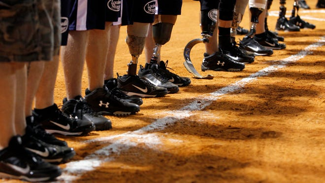 Scenes from the Wounded Warrior Amputee Softball Team vs the Bonita Springs Fire Department 2011 match-up.