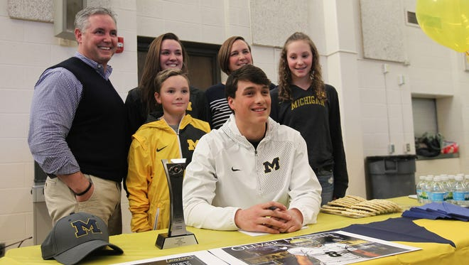 West High senior and Michigan football commit Oliver Martin poses for a photo with his family on Wednesday, Feb. 1, 2017.