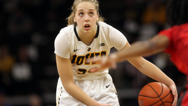 Iowa's Kathleen Doyle sets up a play during the Hawkeyes' game against Rutgers at Carver-Hawkeye Arena on Thursday, Feb. 2, 2017.