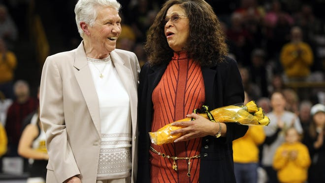 Dr. Christine Grant, left, and C. Vivian Stringer are recognized prior to the Hawkeyes' game against Rutgers at Carver-Hawkeye Arena on Thursday, Feb. 2, 2017.