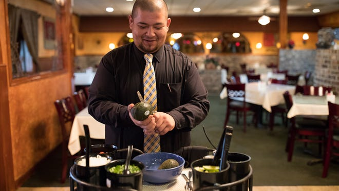 Paul Rowland manager of Senor Jaime's demonstrates how the restaurant makes fresh guacamole table side.