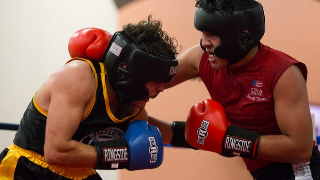 Damian Guajardo of Kingsville boxing club fights against Mark Trevino of Azteca boxing club during the regional Golden Gloves tournament on Saturday, Feb. 4, 2017.