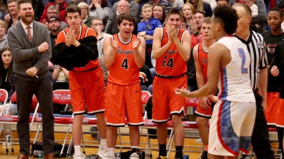 The Sprague bench celebrates a mistake by South Salem's Jaden Nielsen-Skinner (2) in the second half of the Sprague vs. South Salem boy's basketball game at South Salem High School on Friday, Feb. 3, 2017. Sprague won the game 64-58.