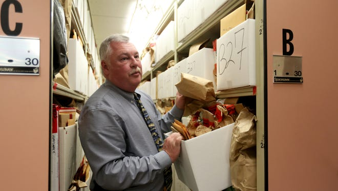Deputy Chief Steve Bellshaw looks through evidence boxes at the Salem Police Department facility at City Hall on Friday, Oct. 14, 2016.