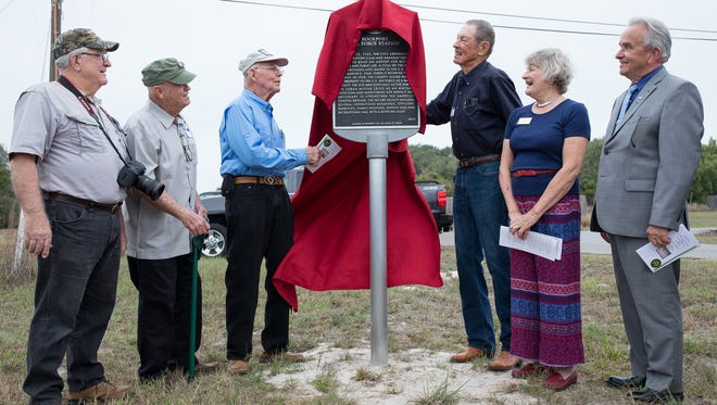 "Retired airman Ken Hartlein (from left), Dallas Ford, Bob Crager, Gordon Stanley, Aransas County Historical Commission member Pam Stranahan and Aransas County Judge C.H. ""Burt"" Mills Jr. reveal a Texas Historical Marker for the Rockport Air Force Station on Tuesday, Feb. 7, 2017, at the Aransas County Airport on Tuesday, Feb. 7, 2017."