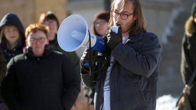 COGS President Landon Elkind speaks to protesters during a walk-out rally at the Pentacrest on Wednesday, Feb. 8, 2017.