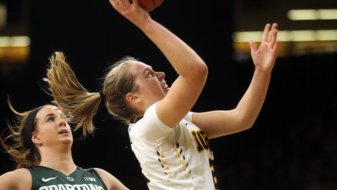 Iowa's Kathleen Doyle goes up for a shot during the Hawkeyes' game against Michigan State at Carver-Hawkeye Arena on Thursday, Feb. 9, 2017.