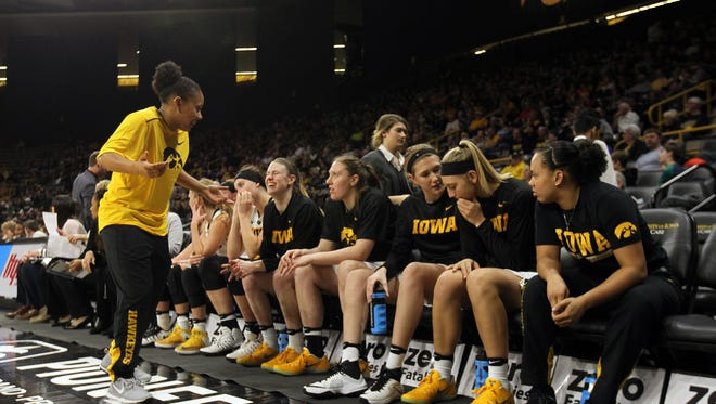 Iowa's Tania Davis chats with teammates during the Hawkeyes' game against Michigan State at Carver-Hawkeye Arena on Thursday, Feb. 9, 2017.