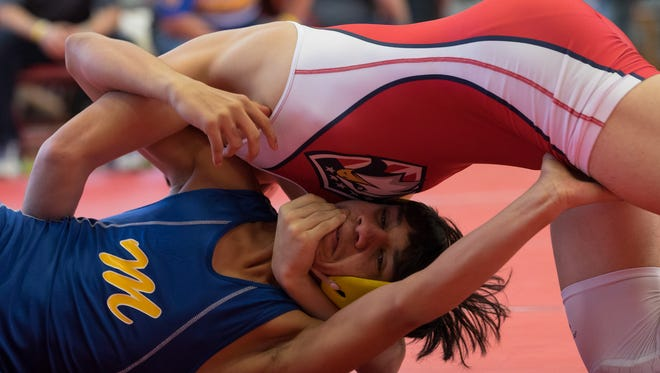 Veterans Memorial's Daniel Leal wrestles with Moody's Israel Gomez in the first place 126 pound wight class match during the second day of the 30-5A wrestling meet at Ray High School on Feb. 9, 2017.