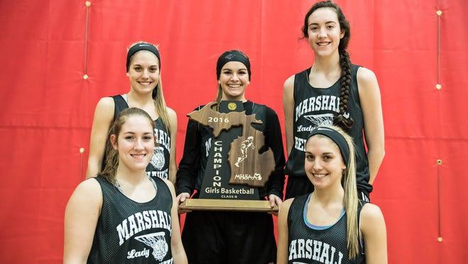 Marshall seniors (clockwise from bottom) Nikki Tucker, Taryn Long, Jill Konkle, Georgianna Pratley, Carlee Long.