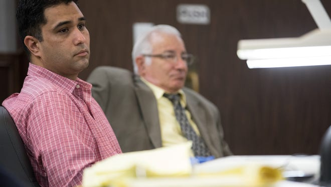 Anthony Molina sits at the defendants' table during closing arguments in his trial on Thursday, Feb.16, 2017, in the 214th District Court in Corpus Christi.