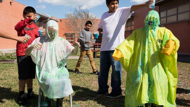 Fifth grade students at Oak Park Elementary School pour slime on their principal Kellye Loving and assistant principal Laura Perales to celebrating hitting their benchmark goals on Friday, Feb. 17, 2017.