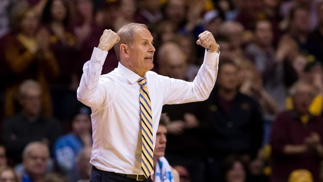 Michigan coach John Beilein signals a play in the second half of U-M's 83-78 overtime loss Sunday in Minneapolis.